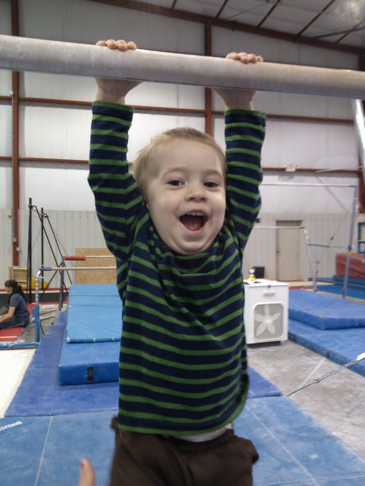 Child hanging on